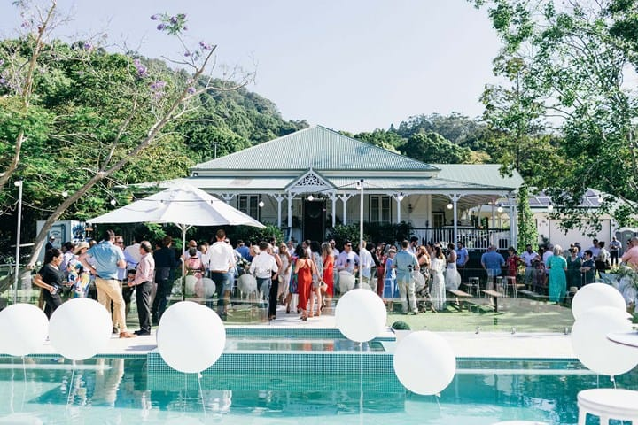 guests standing by the pool